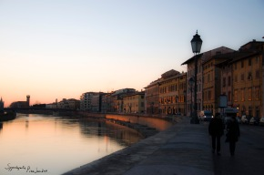 Walking by the river Arno, Pisa, Tuscany.